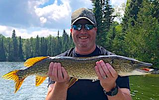 BIG Northern Pike All Smiles Fishing by Shawn at Fireside Lodge in Canada