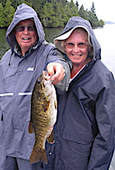 Audrey and Don Fishing in the Rain for Trophy Smallmouth Bass
