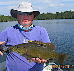 Fishing for Trophy Smallmouth Bass With My Grandson at Fireside Lodge in Canada