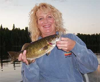 huge trophy smallmoth bass womens fishing in Canada