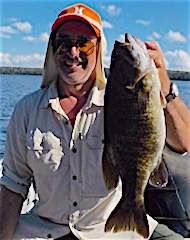 Lawrence with a HUGE Trophy Smallmouth Bass Fishing at Fireside Lodge