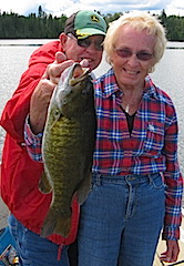 Audrey Fishing for & Catching Trophy Smallmouth Bass at Fireside Lodge