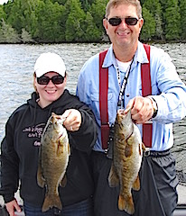 BIG Smallmouth Bass in Doubles Fishing by John and Crystal