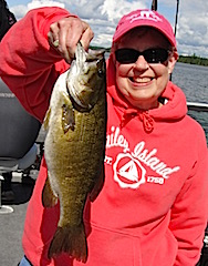 Monica with a Trophy Smallmouth Bass Fishing at Fireside Lodge