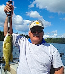GREAT Smallmouth Bass Fishing at Fireside Lodge Canada by Tony Savino