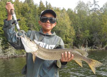 11- Year Old Fishing for BIG Pike at Fireside Lodge Canada
