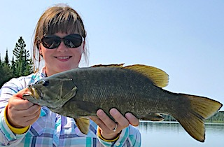 Large Trophy Smallmouth Bass Fishing by Crystal in Canada