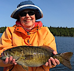 HUGE Trophy Smallmouth Bass Fishing by Monica at Fireside Lodge in Canada