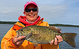 Super Smile Super Smallmouth Bass Fishing by Monica at Fireside Lodge in Canada