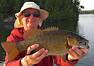 Many Trophy Smallmouth Bass Fishing at Fireside Lodge in Canada by John