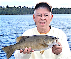 Larry Himshaw With a Trophy Smallmouth Bass Fishing at Fireside Lodge