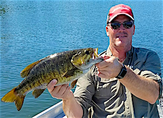 HUGE Trophy Smallmouth Bass by Jim Fishing at Fireside Lodge