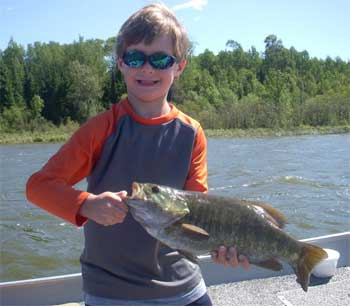 kids fishing for trophy smallmouth bass in Canada