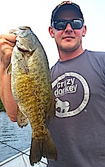 HUGE Trophy Smallmouth Bass Fishing by Justin at Fireside Lodge