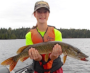 Silvia Fishing for Northern Pike at Fireside Lodge