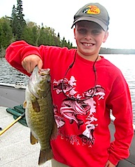 Tyler Klimes with BIG Smallmouth Bass Fishing at Fireside Lodge Canada