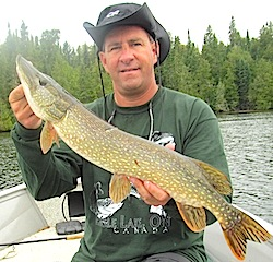 Father & Son Northern Pike Fishing at Fireside Lodge Canada by Brian Klimes