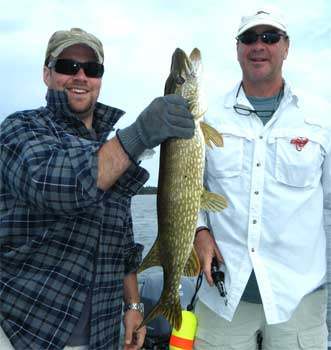 Father & Son Fishing Northern Pike at Fireside Lodge in Canada Lakes
