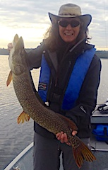 Jane with a LARGE Northern Pike Fishing at Fireside Lodge in Canada