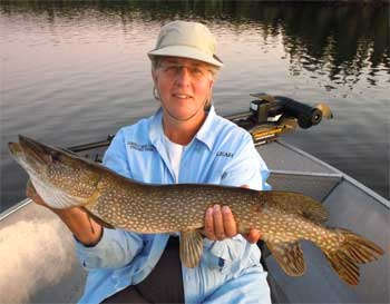 ladies fly fishing at canada lodges for northern  pike