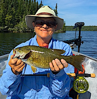 Fly-Fishing Smallmouth Bass Brings a Smile to Paula at Fireside Lodge in Canada