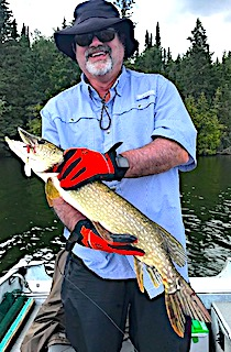 Dennis With One of Many Northern Pike Fishing at Fireside Lodge in Canada