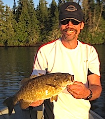 Trophy Smallmouth Bass Fishing Smile at Fireside Lodge Canada by Bill