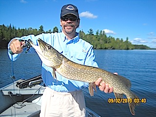 BIG Northern Pike Fishing at Fireside Lodge Canada by Bill Calhoon