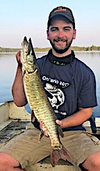 Walker With 1 of his Muskie on a 5 Muskie Day Fishing at Fireside Lodge in Canada