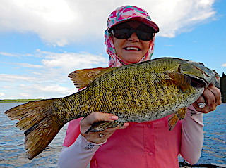 Lisa with a GIANT Trophy Smallmouth Bass Fishing at Fireside Lodge in Canada