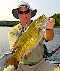 Monster 21-inch Smallmouth Bass Fishing by Eric at Fireside Lodge in Canada