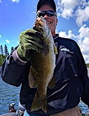 BIG Smallmouth Bass are Fun by Ken at Fireside Lodge in Canada