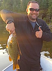 Thumbs Up to Trophy Smallmouth Bass Fishing at Fireside Lodge by Adam