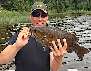 Giant Trophy Smallmouth Bass Fishing at Fireside Lodge by Jason