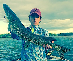 Ryan with a BIG Northern Pike Fishing at Fireside Lodge