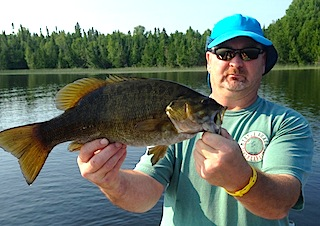 HUGE Trophy Smallmouth Bass Fishing by Michael at Fireside Lodge