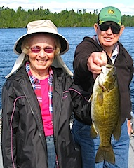 Audrey Fishing for Trophy Smallmouth Bass at Fireside Lodge Canada