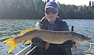 Trolling For Large Northern Pike Fishing at Fireside Lodge in Canada