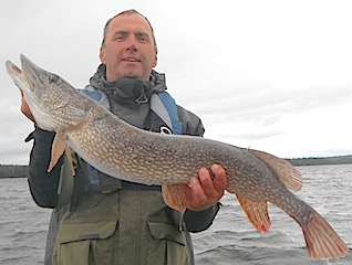 Tim Stewart with another GIANT Northern Pike fishing at Fireside Lodge